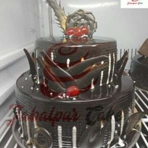 chocolaty cake with cherry on top
